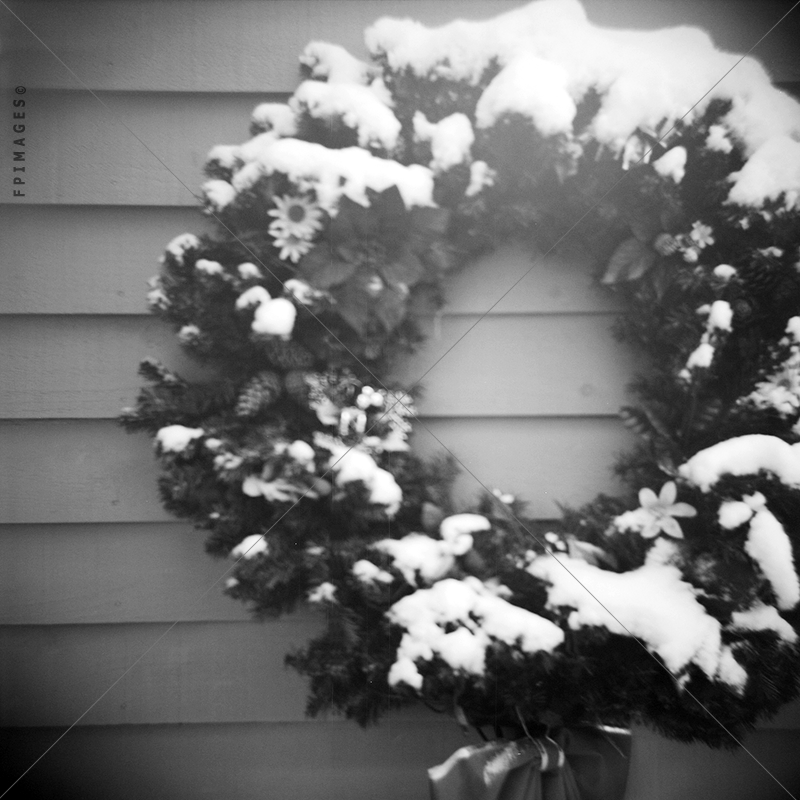 Snow covered christmas wreath B&W photo