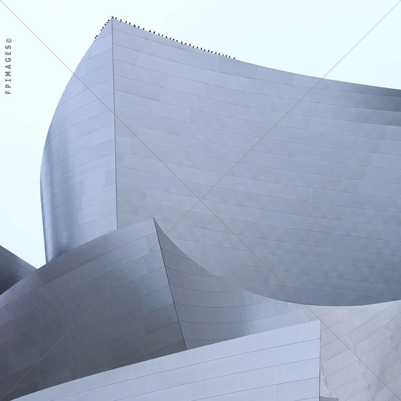 Stainless Steel Exterior of Walt Disney concert hall, birds perched up