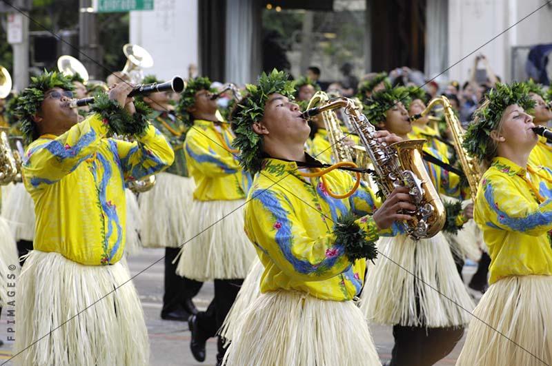 Brass Band marching in pau hula skirts, saxophone player