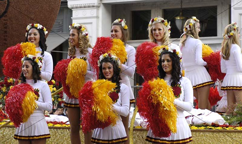 American football girls cheerleaders with red and yellow pom poms