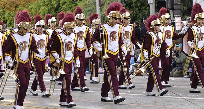 Street photo of marching Brass Band at Tournament of Roses Parade, USC Trojans