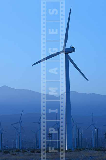 single modern wind turbine, California desert blue industrial landscape