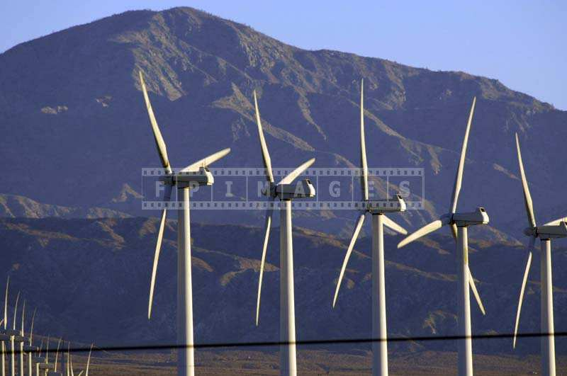 WindMills and Mountains at Sunrise Landscape