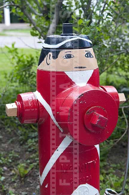 Red firefighting hydrant decorated as British loyalist