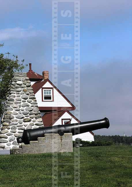 Old gun and lighthouse building picture