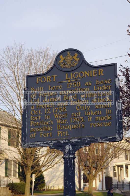 Street photo of memorial plaque
