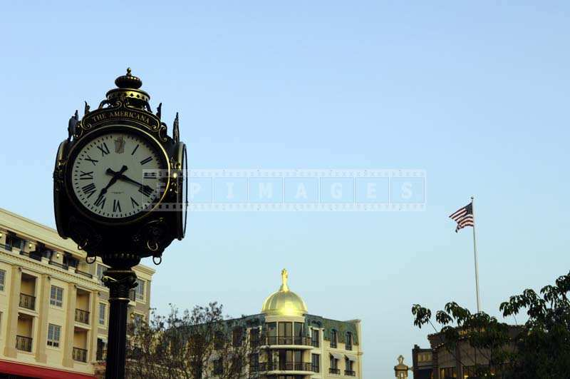 "A Graceful Clock Post with ""The Americana"" Sign"