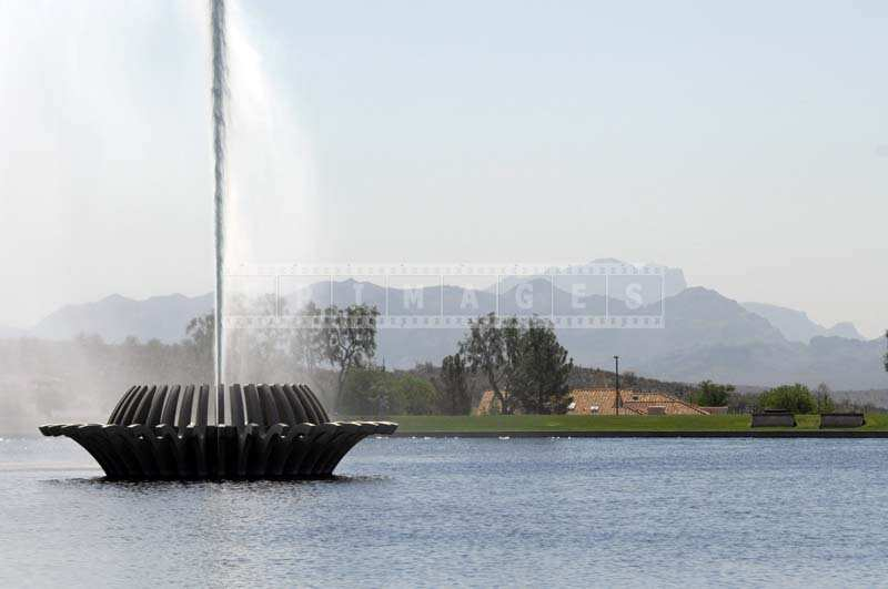Fountain with the desert and  mountains landscape as backdrop