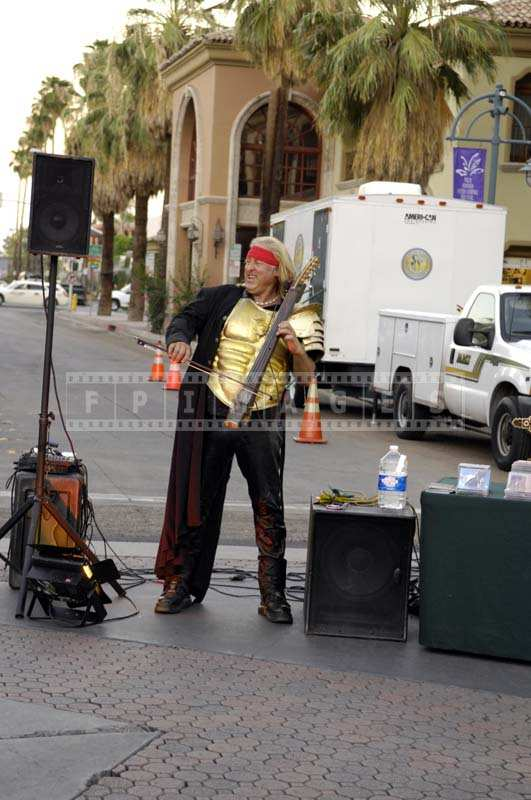 Thursday market - A Street Musician Filling the Air with Music