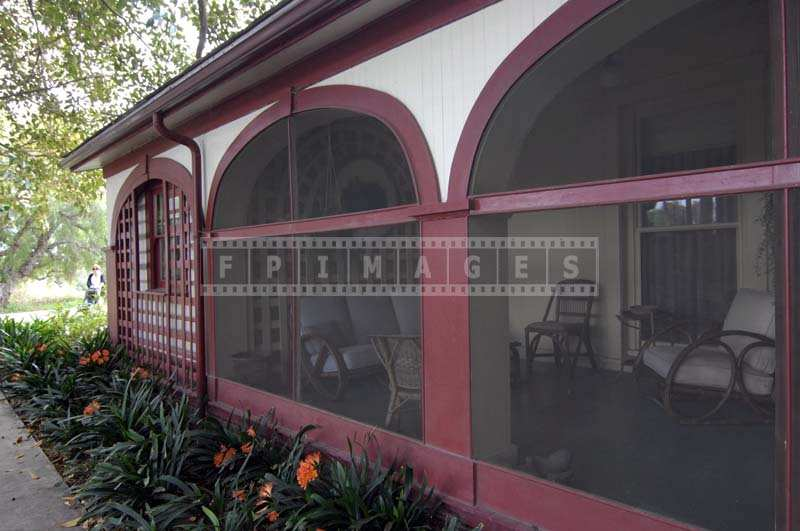 Red and white building and inviting veranda