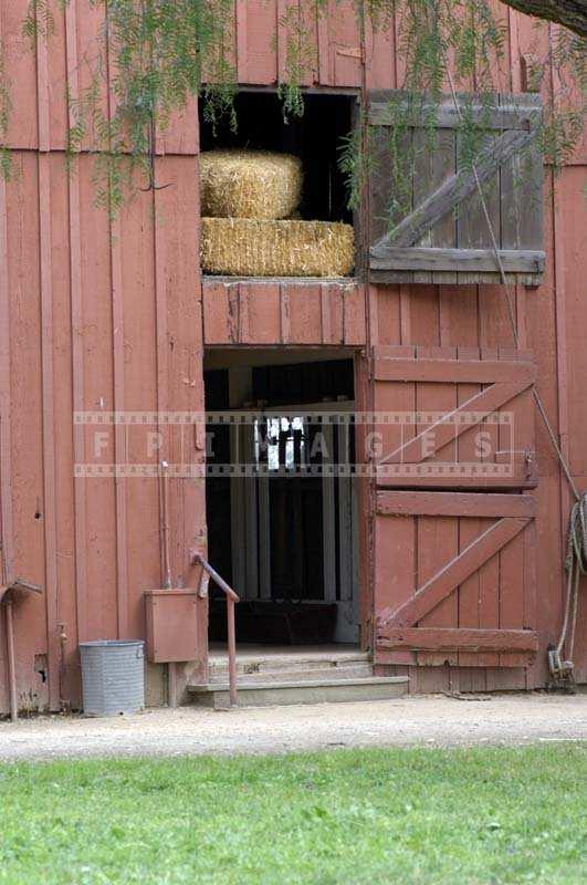 Old reddish barn with hay