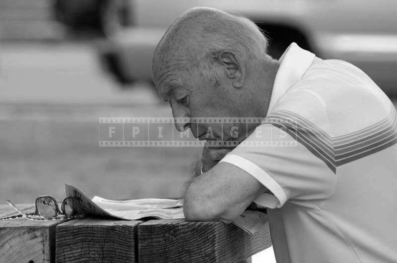 A Senior Citizen Reading Paper