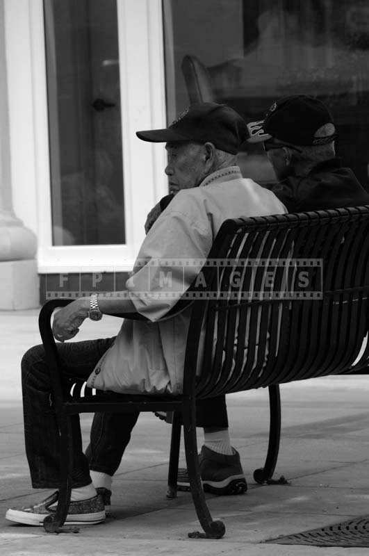 Senior Citizens Sitting on a Bench