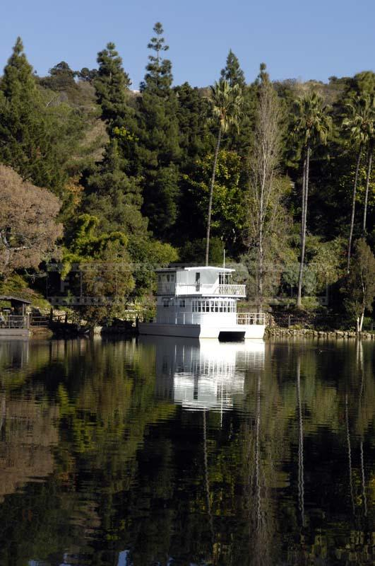 White Houseboat Reflecting in the Lake