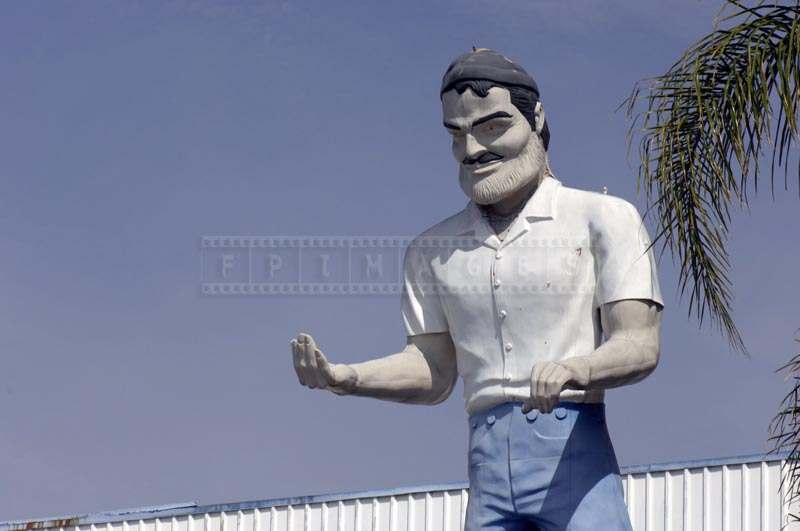 Close View of the Smog Check Muffler Man