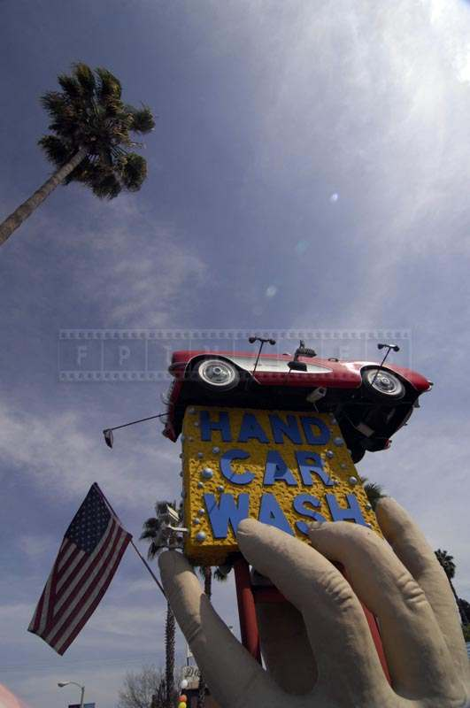 Hand Car Wash Sculpture with American Flag