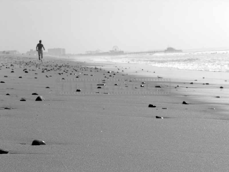 A jogger on the beach in Santa Monica
