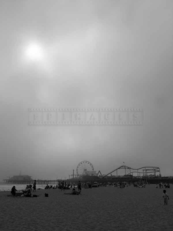 Beach and the pier on a foggy day