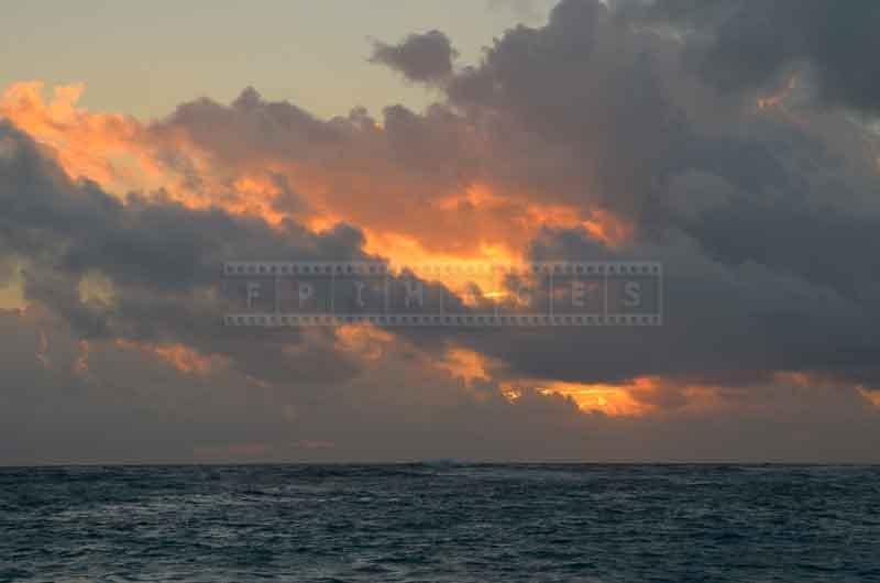 Dramatic golden sunrise at Bavaro beach