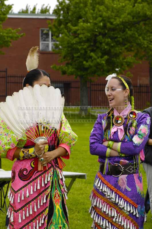 Jingle Dancers with a white feather fan