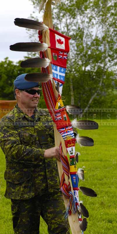 Soldier holds First Nations of Canada symbols