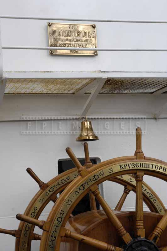 Ship construction plaque, bronze shiny bell and steering wheel
