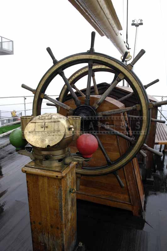 Ship's wheel and compass
