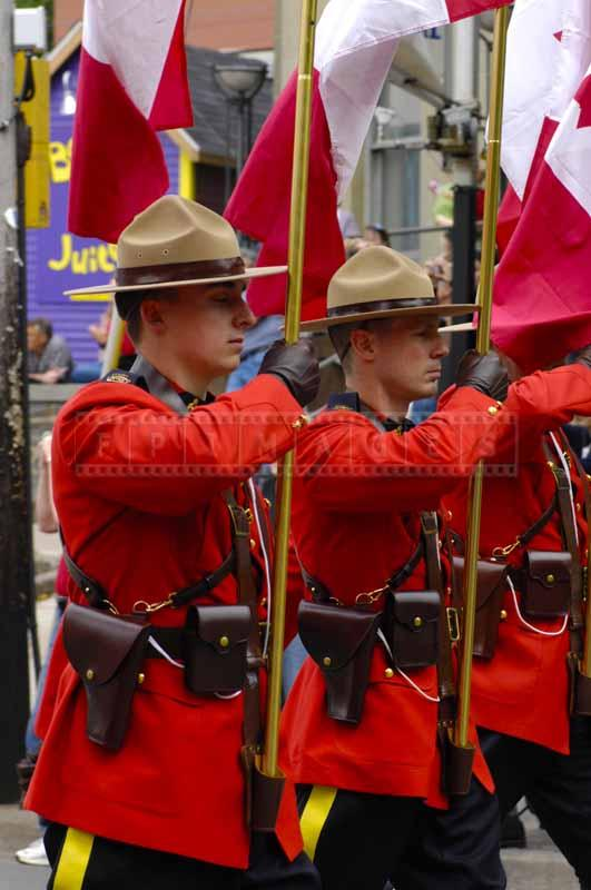 Flag carrying RCMP personnel