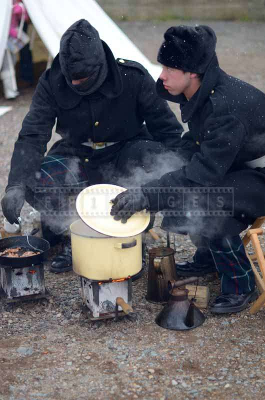 Two soldiers cooking