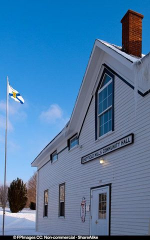 Community Hall in January with Nova Scotia flag, free image