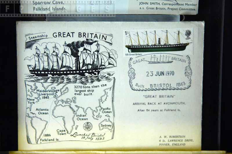 Royal mail stamp and map of voyages on the postcard