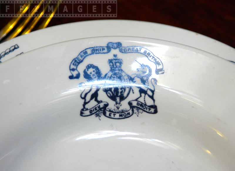 Blue crest on tableware