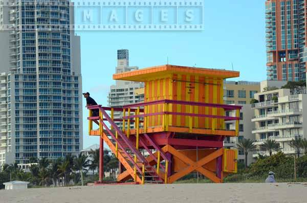 Person at the lifeguard tower, orange and yellow colors