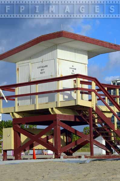 Brown, yellow and white lifeguard hut