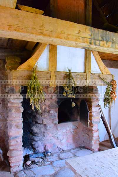 Stone bake oven and fireplace, interiors of Acadian house