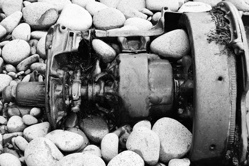 Detail of an old gear box, industrial pollution of the beach