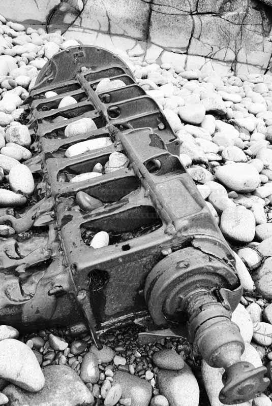 industrial images - old wrecked machine on the beach