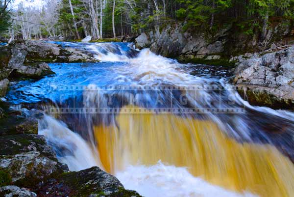 Strong flow of the river, whitewater and rapids, Millet Falls