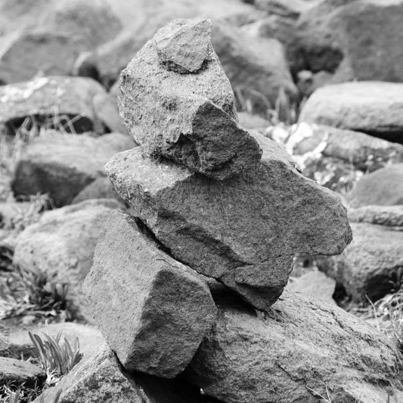 native Americans put rocks togehter to make inukshuk, abstract images