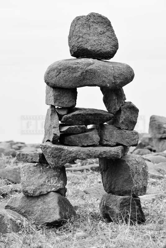 Inukshuk resembling human, abstract images