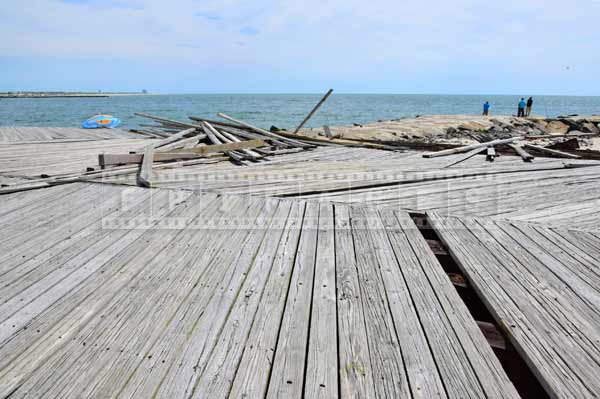 atlantic city boardwalk missing and ripped apart boards, urban decay