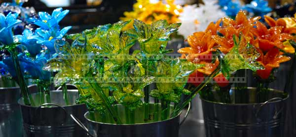 Glass flowers - delicate still life gifts at museum glass market, travel images