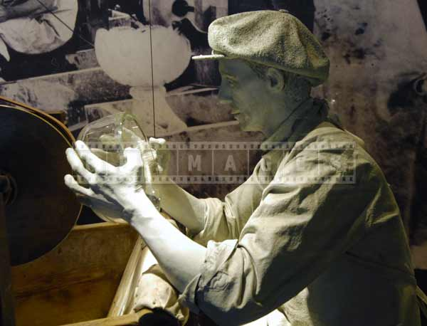 Man polishing crystal bowl, industrial images