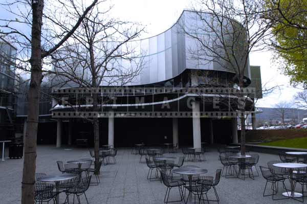 Museum of glass courtyard with cafe tables, pictures of buildings