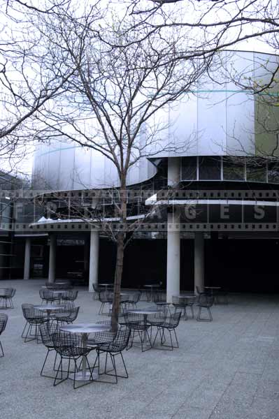 Museum of glass courtyard with cafe tables, cityscapes