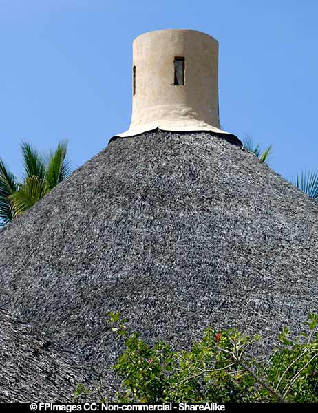 Chimney on top of palapa thatched roof, architectural photos