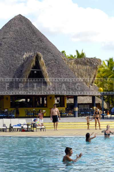 Caribbean beach scenes with palapa buildings