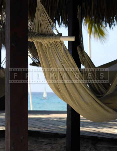 Romantic setting - relax in a beachfront hammock under the thatched roof
