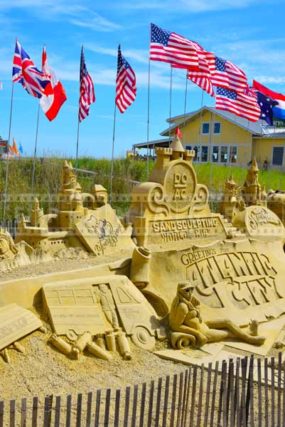 sand castle competition 2014 atlantic cty display with flags near boardwalk