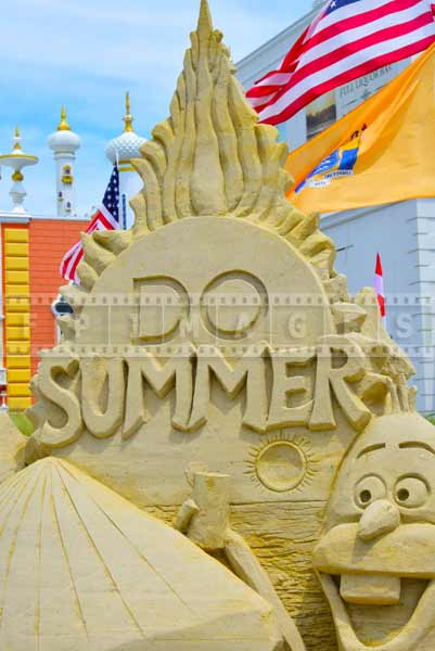 Sand castle competition logo saying : DO SUMMER, near Taj Mahal Hotel and Casino